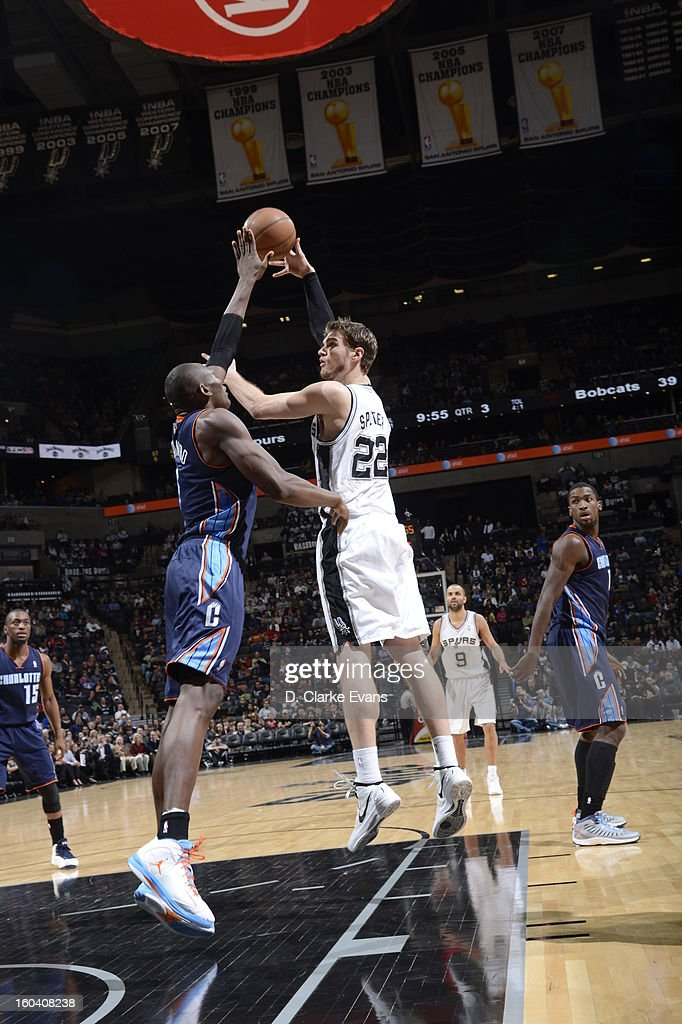<a gi-track='captionPersonalityLinkClicked' href=/galleries/search?phrase=Tiago+Splitter&family=editorial&specificpeople=208218 ng-click='$event.stopPropagation()'>Tiago Splitter</a> #22 of the San Antonio Spurs goes up for the hook shot while <a gi-track='captionPersonalityLinkClicked' href=/galleries/search?phrase=Bismack+Biyombo&family=editorial&specificpeople=7640443 ng-click='$event.stopPropagation()'>Bismack Biyombo</a> #0 of the Charlotte Bobcats attempts to block it on January 30, 2013 at the AT&T Center in San Antonio, Texas.