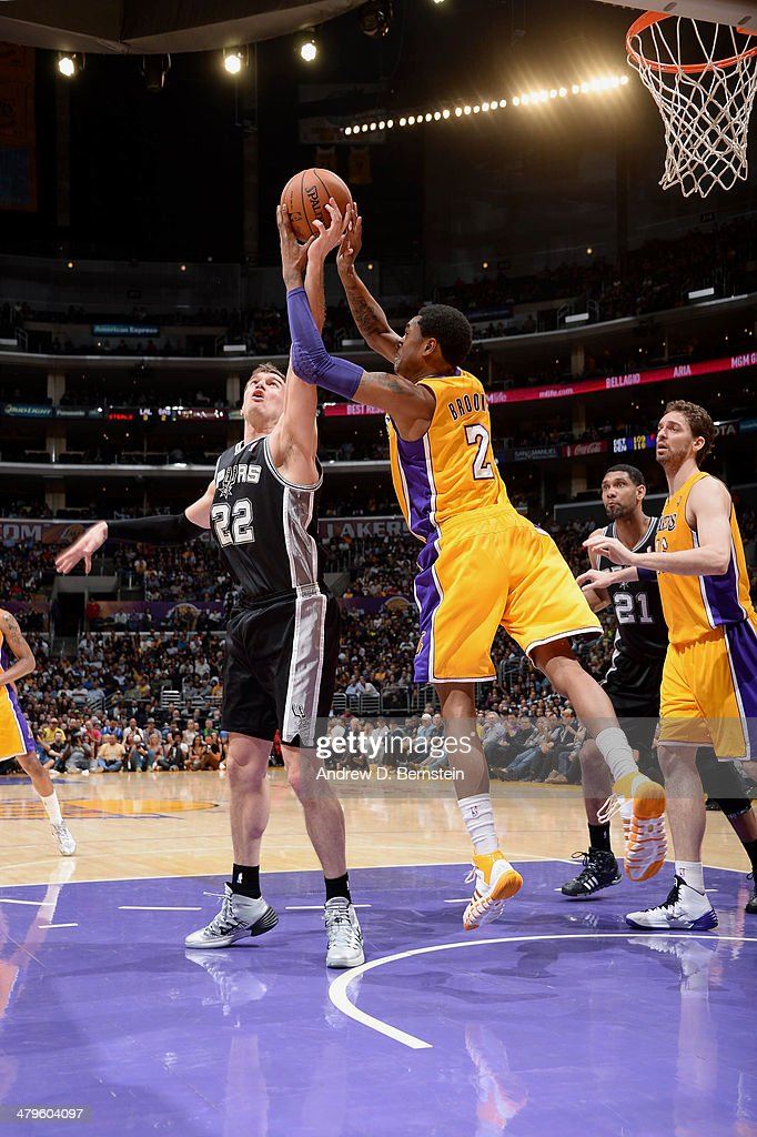 <a gi-track='captionPersonalityLinkClicked' href=/galleries/search?phrase=Tiago+Splitter&family=editorial&specificpeople=208218 ng-click='$event.stopPropagation()'>Tiago Splitter</a> #22 of the San Antonio Spurs grabs a rebound against <a gi-track='captionPersonalityLinkClicked' href=/galleries/search?phrase=MarShon+Brooks&family=editorial&specificpeople=4884862 ng-click='$event.stopPropagation()'>MarShon Brooks</a> #2 of the Los Angeles Lakers at Staples Center on March 19, 2014 in Los Angeles, California.