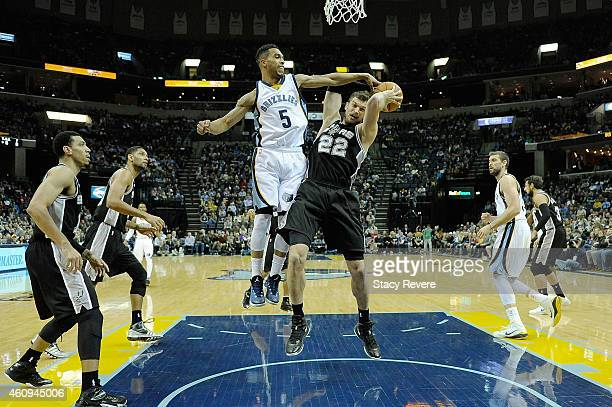 Tiago Splitter of the San Antonio Spurs is defended by Courtney Lee of the Memphis Grizzlies during a game at the FedExForum on December 30 2014 in...