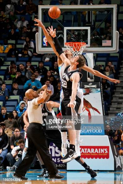 Tiago Splitter of the San Antonio Spurs reaches for a jump ball against Anthony Davis of the New Orleans Hornets on January 7 2013 at the New Orleans...