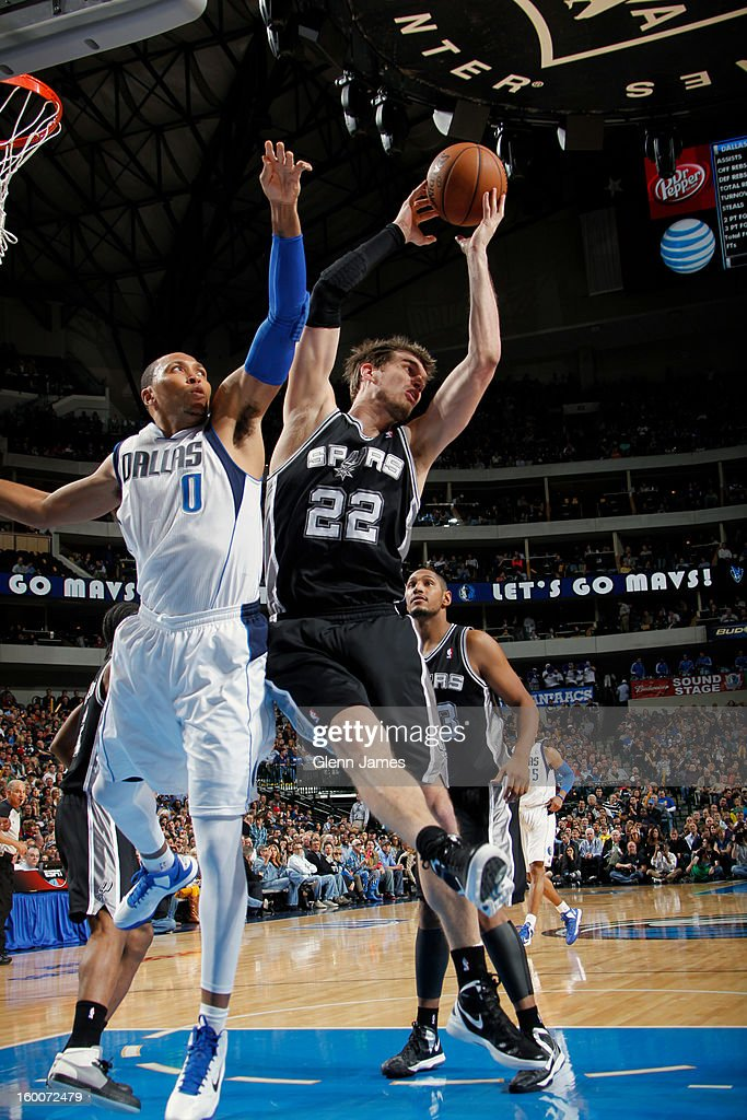 Tiago Splitter #22 of the San Antonio Spurs rebounds against Shawn Marion #0 of the Dallas Mavericks on January 25, 2013 at the American Airlines Center in Dallas, Texas.