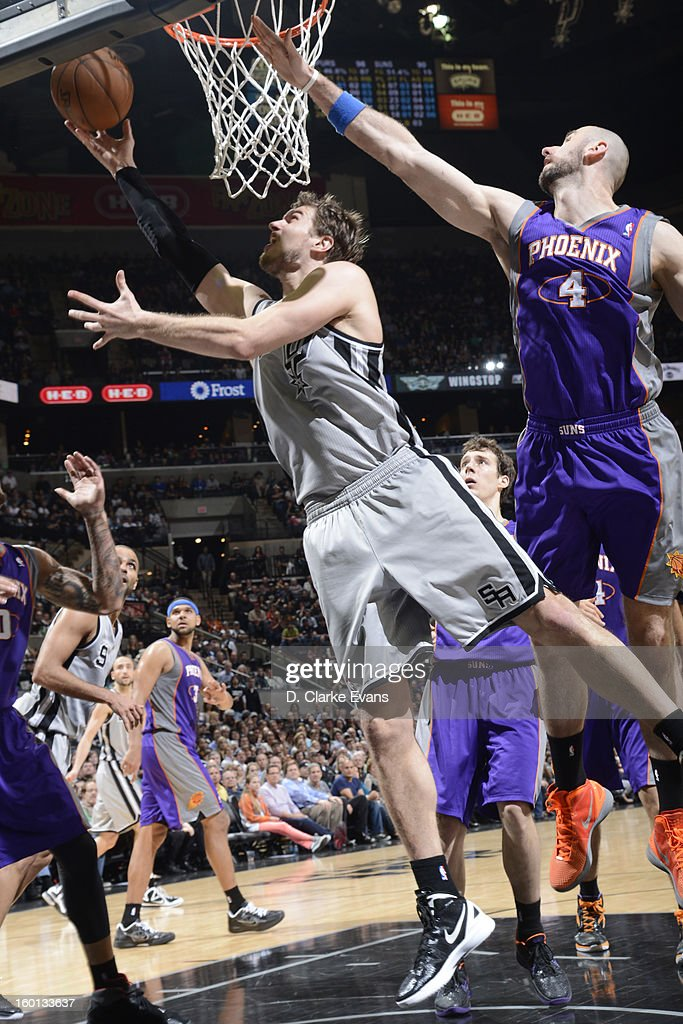 Tiago Splitter #22 of the San Antonio Spurs shoots a layup against Marcin Gortat #4 of the Phoenix Suns on January 26, 2013 at the AT&T Center in San Antonio, Texas.