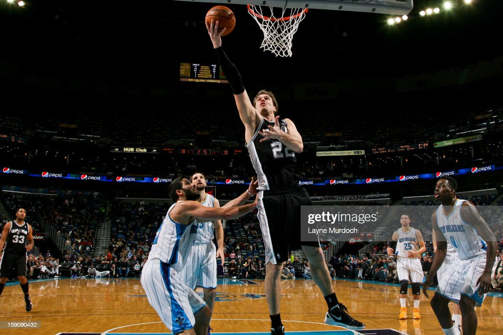 Tiago Splitter #22 of the San Antonio Spurs shoots a layup against Greivis Vasquez #21 of the New Orleans Hornets on January 7, 2013 at the New Orleans Arena in New Orleans, Louisiana.