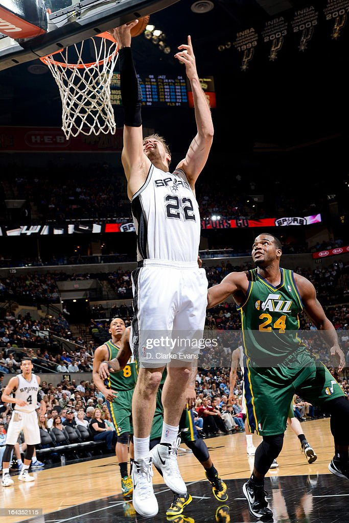 Tiago Splitter #22 of the San Antonio Spurs shoots a layup against Paul Millsap #24 of the Utah Jazz on March 22, 2013 at the AT&T Center in San Antonio, Texas.