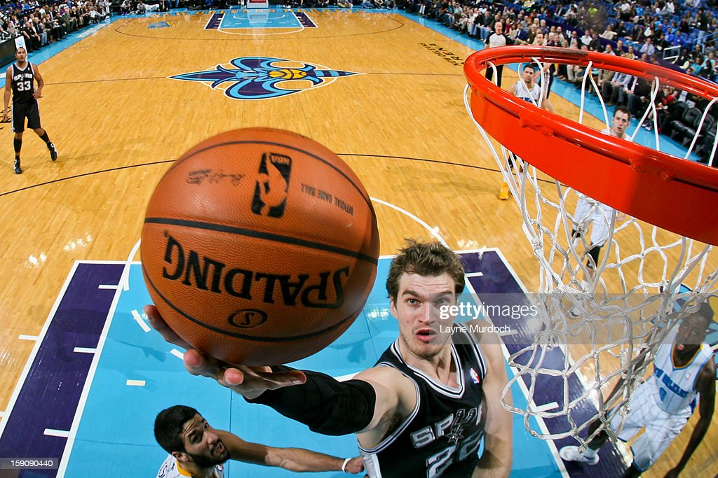 Tiago Splitter #22 of the San Antonio Spurs shoots a layup against the New Orleans Hornets on January 7, 2013 at the New Orleans Arena in New Orleans, Louisiana.