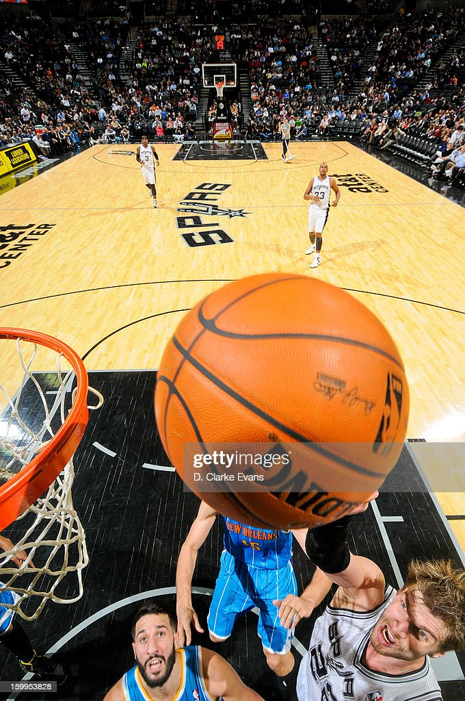 <a gi-track='captionPersonalityLinkClicked' href=/galleries/search?phrase=Tiago&family=editorial&specificpeople=208218 ng-click='$event.stopPropagation()'>Tiago</a> Splitter #22 of the San Antonio Spurs shoots a layup against the New Orleans Hornets on January 23, 2013 at the AT&T Center in San Antonio, Texas.