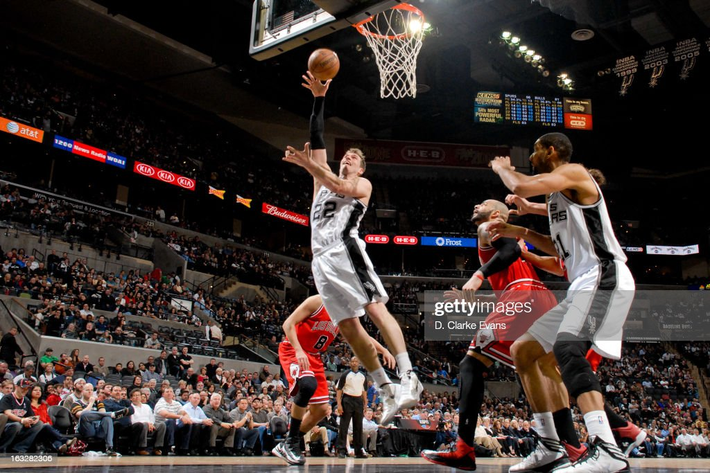 <a gi-track='captionPersonalityLinkClicked' href=/galleries/search?phrase=Tiago&family=editorial&specificpeople=208218 ng-click='$event.stopPropagation()'>Tiago</a> Splitter #22 of the San Antonio Spurs shoots a layup against the Chicago Bulls on March 6, 2013 at the AT&T Center in San Antonio, Texas.