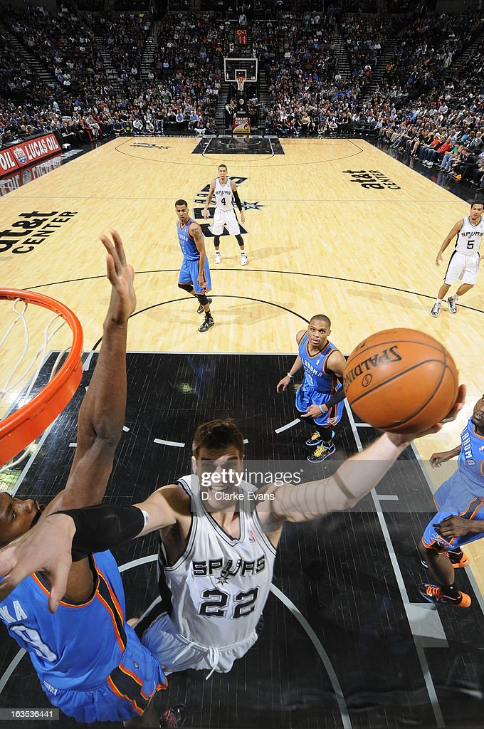 <a gi-track='captionPersonalityLinkClicked' href=/galleries/search?phrase=Tiago+Splitter&family=editorial&specificpeople=208218 ng-click='$event.stopPropagation()'>Tiago Splitter</a> #22 of the San Antonio Spurs shoots against <a gi-track='captionPersonalityLinkClicked' href=/galleries/search?phrase=Serge+Ibaka&family=editorial&specificpeople=5133378 ng-click='$event.stopPropagation()'>Serge Ibaka</a> #9 of the Oklahoma City Thunder on March 11, 2013 at the AT&T Center in San Antonio, Texas.
