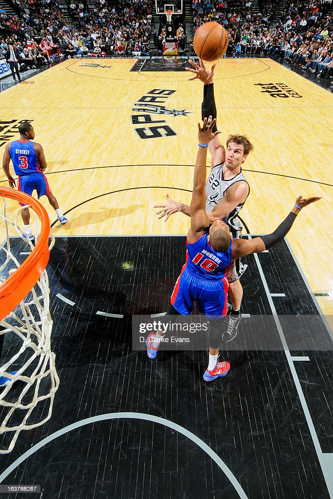 Tiago Splitter #22 of the San Antonio Spurs shoots in the lane against Greg Monroe #10 of the Detroit Pistons on March 3, 2013 at the AT&T Center in San Antonio, Texas.