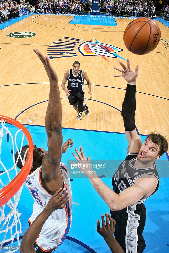 Tiago Splitter #22 of the San Antonio Spurs shoots in the lane against Kendrick Perkins #5 of the Oklahoma City Thunder on April 4, 2013 at the Chesapeake Energy Arena in Oklahoma City, Oklahoma.