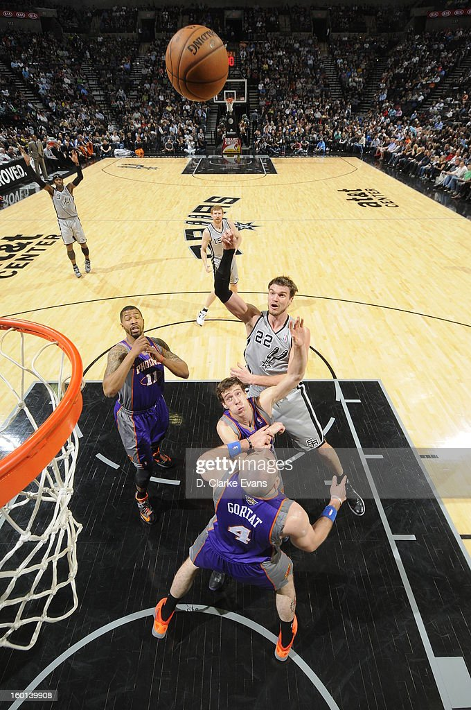 Tiago Splitter #22 of the San Antonio Spurs shoots over Goran Dragic #1 and Marcin Gortat #4 of the Phoenix Suns on January 26, 2013 at the AT&T Center in San Antonio, Texas.