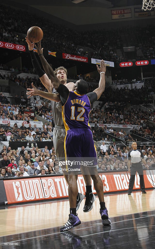 Tiago Splitter #22 of the San Antonio Spurs shoots the ball over Dwight Howard #12 of the Los Angeles Lakers during the Game One of the Western Conference Quarterfinals between the Los Angeles Lakers and the San Antonio Spurs on April 21, 2013 at the AT&T Center in San Antonio, Texas.