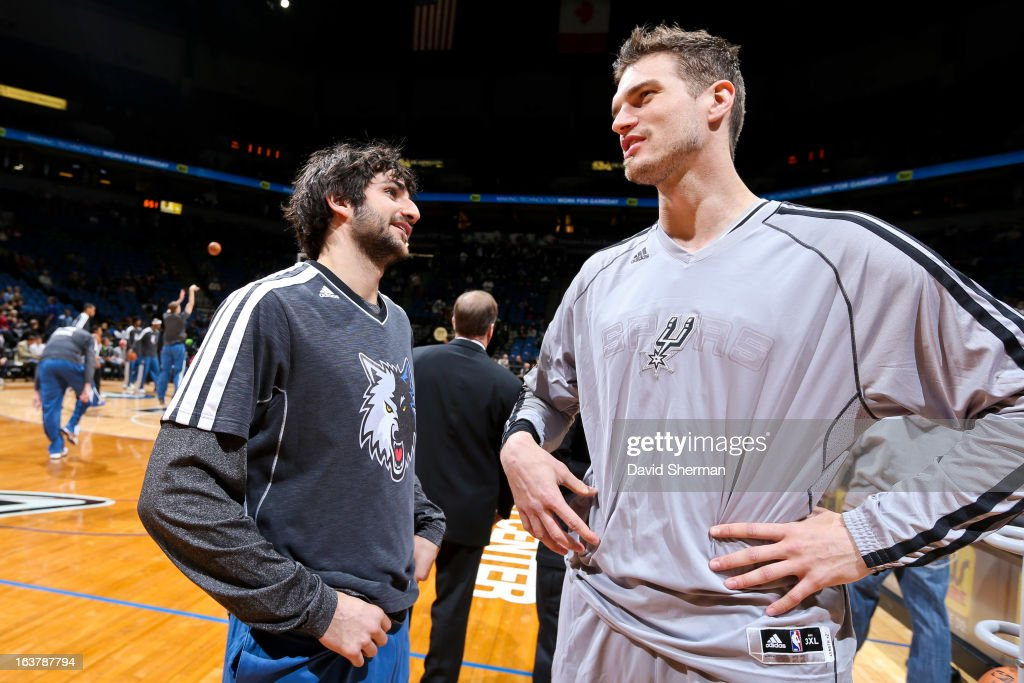 <a gi-track='captionPersonalityLinkClicked' href=/galleries/search?phrase=Tiago+Splitter&family=editorial&specificpeople=208218 ng-click='$event.stopPropagation()'>Tiago Splitter</a> #22 of the San Antonio Spurs speaks with <a gi-track='captionPersonalityLinkClicked' href=/galleries/search?phrase=Ricky+Rubio&family=editorial&specificpeople=4028920 ng-click='$event.stopPropagation()'>Ricky Rubio</a> #9 of the Minnesota Timberwolves before their game on March 12, 2013 at Target Center in Minneapolis, Minnesota.