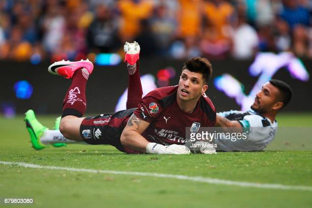 Tiago Volpi and Miguel Martinez of Queretaro react during a match between Queretaro against Tigres as part of the Clausura Tournament 2017 league...