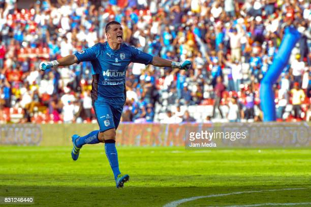 Tiago Volpi Goalkeeper of Queretaro celebrates his team second goal during the 4th round match between Queretaro and Morelia as part of the Torneo...