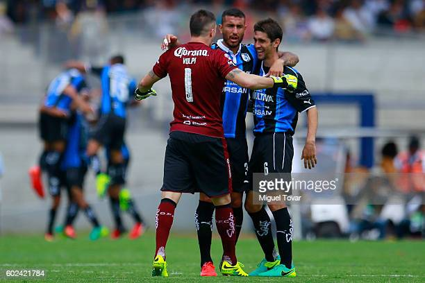 Tiago Volpi goalkeeper of Queretaro celebrates with teammates after a goal scored by Neri Cardozo of Queretaro during the 8th round match between...