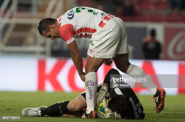 Tiago Volpi goalkeeper of Queretaro holds the ball as Mario de Luna of Necaxa reacts during the 7th round match between Necaxa and Queretaro as part...