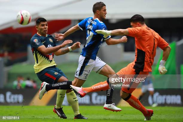 Tiago Volpi goalkeeper of Queretaro kicks off the ball as Silvio Romero of America and Hiram Mier of Querataro run during the 1st round match between...