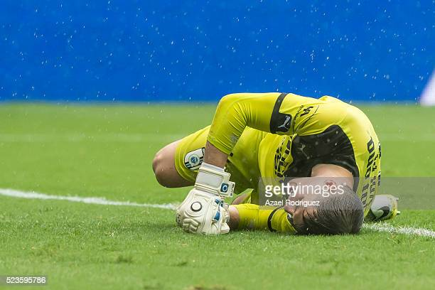 Tiago Volpi goalkeeper of Queretaro stays on the ground after receiving a goal during the 15th round match between Monterrey and Queretaro as part of...