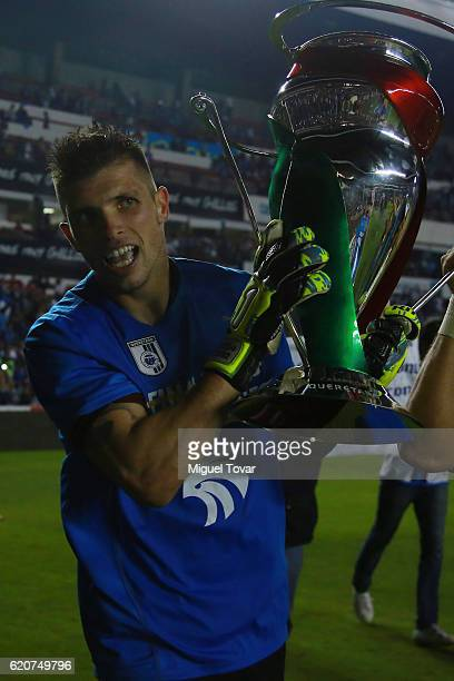 Tiago Volpi of Queretaro celebrates with the trophy after winning the final match between Queretaro and Chivas as part of the Copa MX Apertura 2016...