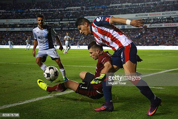 Tiago Volpi of Queretaro fights for the ball with Alan Pulido of Chivas during the final match between Queretaro and Chivas as part of the Copa MX...