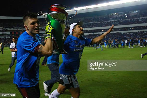 Tiago Volpi of Queretaro lifts the trophy after winning the final match between Queretaro and Chivas as part of the Copa MX Apertura 2016 at La...