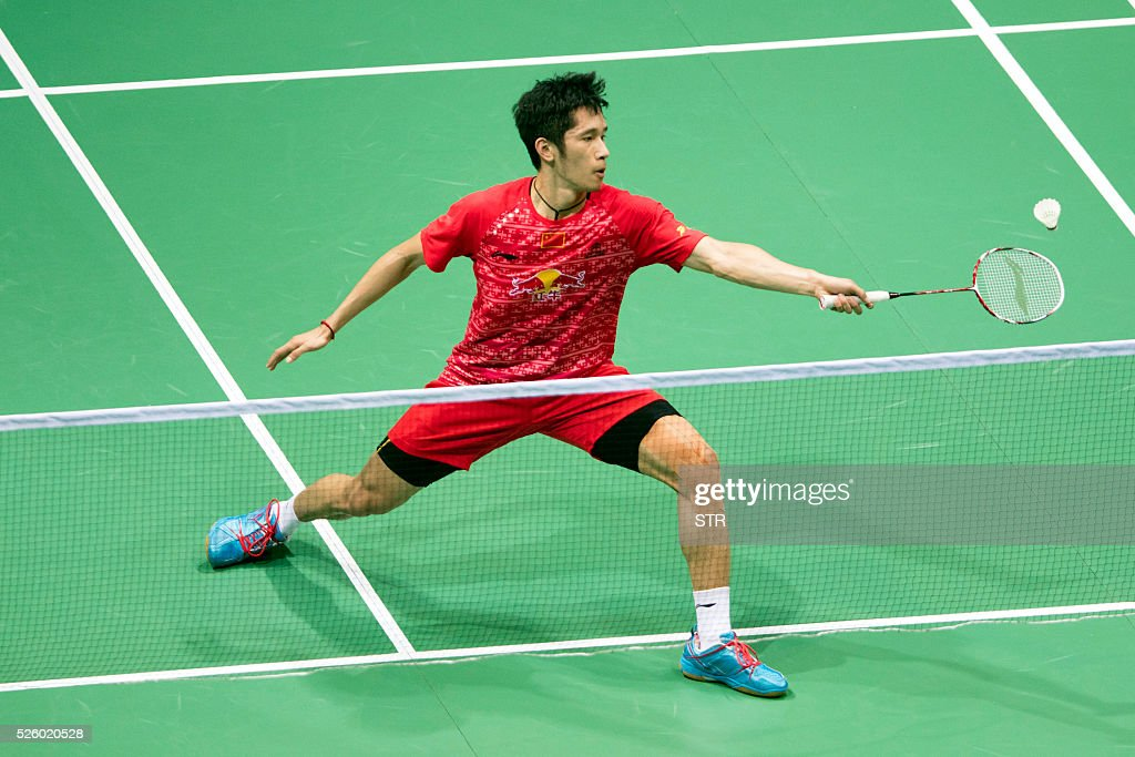 Tian Houwei of China hits a return against Tzu Wei Wang of Taipei during their men's singles quarter-final match at the 2016 Badminton Asia Championships in Wuhan, central China's Hubei province on April 29, 2016. / AFP / STR