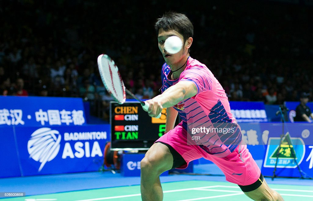 Tian Houwei of China hits a return to Chen Long of China during their men's singles semi-final match at the 2016 Badminton Asia Championships in Wuhan, central China's Hubei province on April 30, 2016. / AFP / STR