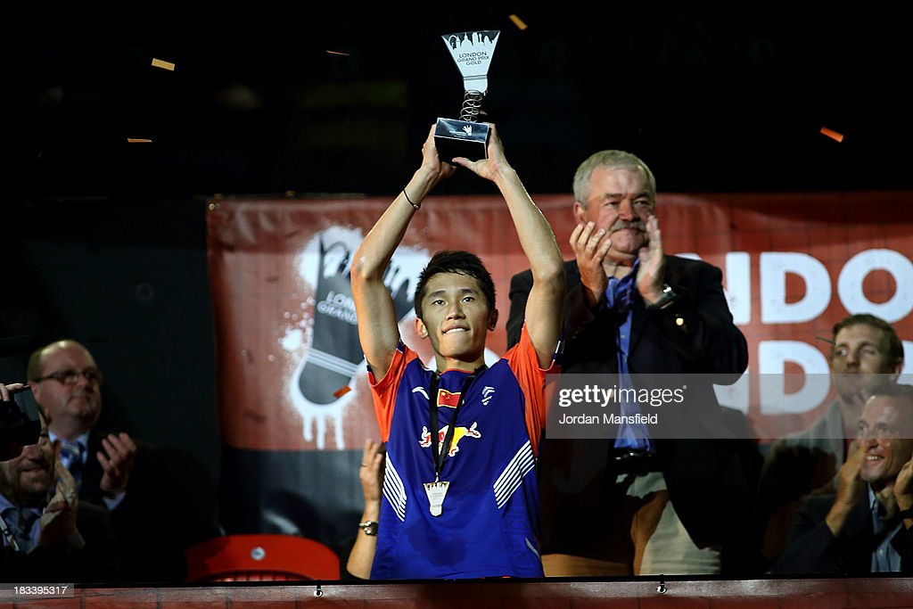 Tian Houwei of China holds the trophy after winning in the the men's singles final against Hans-Kristian Vittinghus of Denmark during Day 6 of the London Badminton Grand Prix at The Copper Box on October 6, 2013 in London, England.