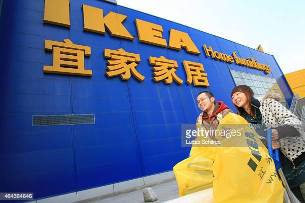 Tian Ping male and Yuan Lishan female walk out of IKEA Shanghai with their purchases on January 31 2008 in Shanghai China
