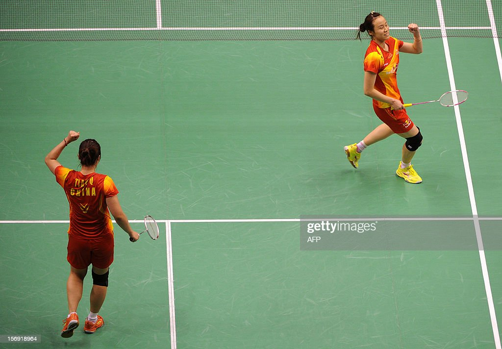 Tian Qing (L) and Zhao Yunlei (R) of China celebrate after beating compatriots Wang Xiaoli and Yu Yang in the women's doubles final at the Hong Kong Open badminton tournament on November 25, 2012. AFP PHOTO / Dale de la Rey