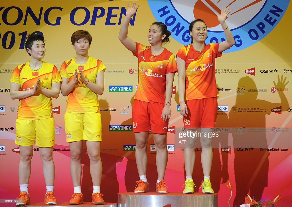 Tian Qing (2nd R) and Zhao Yunlei (R) of China celebrate on the podium after beating compatriots Wang Xiaoli (2nd L) and Yu Yang (L) in the women's doubles final at the Hong Kong Open badminton tournament on November 25, 2012. AFP PHOTO / Dale de la Rey