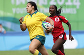 Tiana Penitani of Australia runs with the ball and scores a try at the Rugby Sevens Final on day four of the Nanjing 2014 Summer Youth Olympic Games...