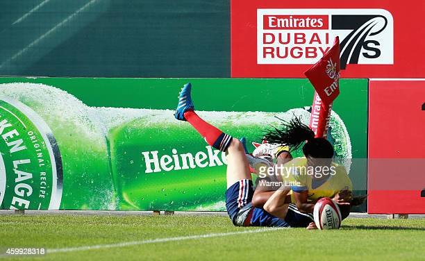 Tiana Penitani of Australia scores a try against France during the IRB Women's Sevens Rugby World Series at the Emirates Dubai Rugby Sevens on...
