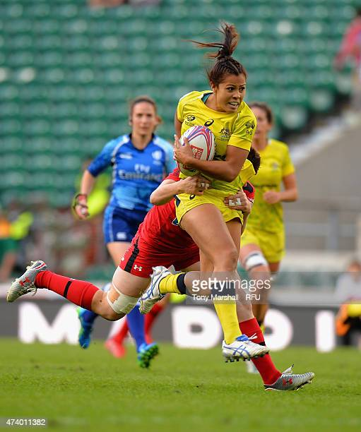 Tiana Penitani of Australia tackled by Brittany Benn of Canada during the Marriott London Sevens Women's Final match between Canada and Australia on...