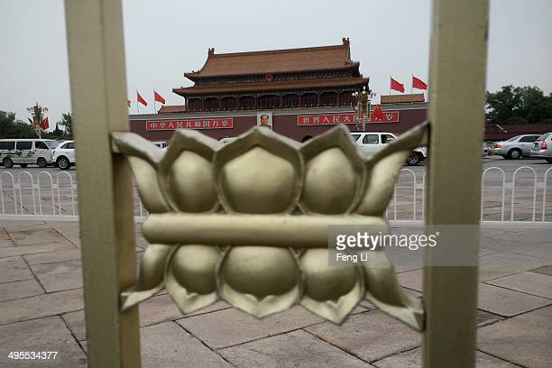 Tiananmen Gate stands behind the fence on Tiananmen Square on June 4 2014 in Beijing China Twentyfive years ago on June 4 1989 Chinese troops cracked...