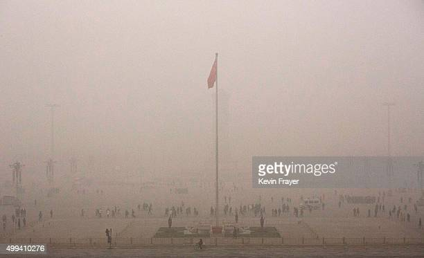 Tiananmen Square is seen in heavy smog on a day of high pollution on December 1 2015 in Beijing China China's capital and many cities in the northern...