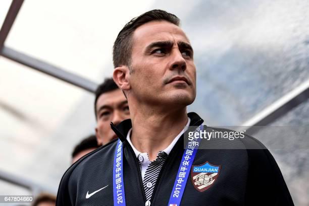 Tianjin Quanjian's head coach Fabio Cannavaro looks on before the Chinese Super League match against Guangzhou RF in Guangzhou south China's...