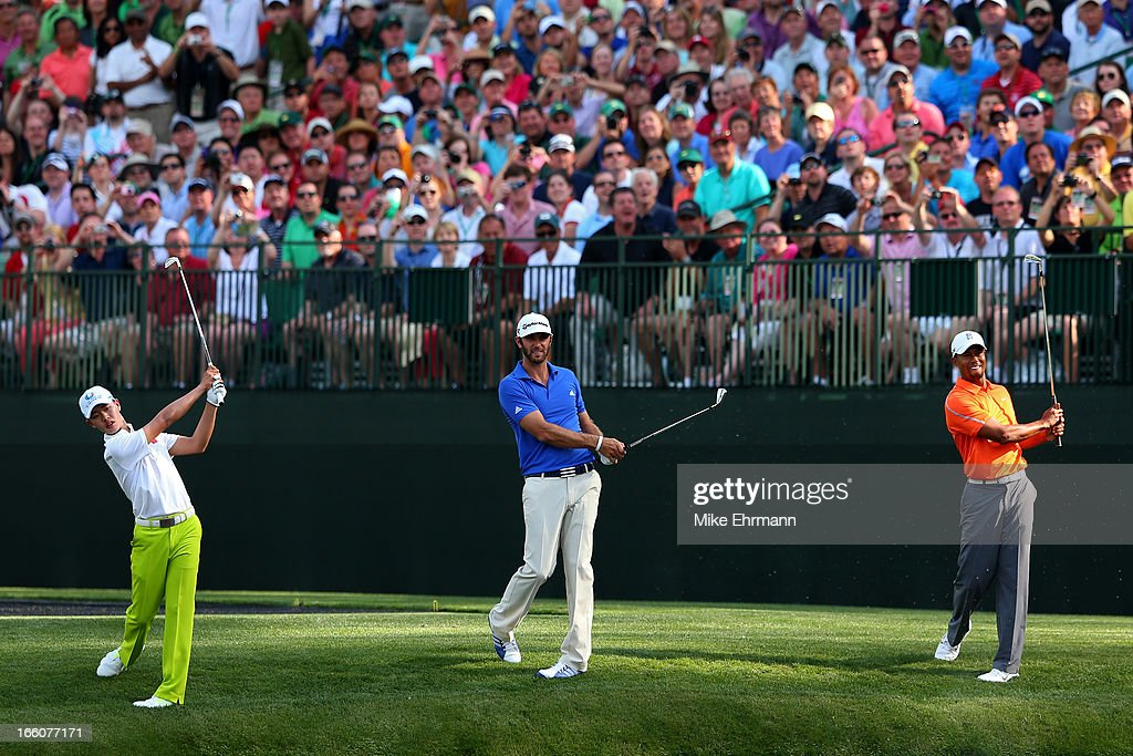 Tianlang Guan of China, Dustin Johnson of the United States and Tiger Woods of the United States all hit a shot at the same time on the 16th hole during a practice round prior to the start of the 2013 Masters Tournament at Augusta National Golf Club on April 8, 2013 in Augusta, Georgia.