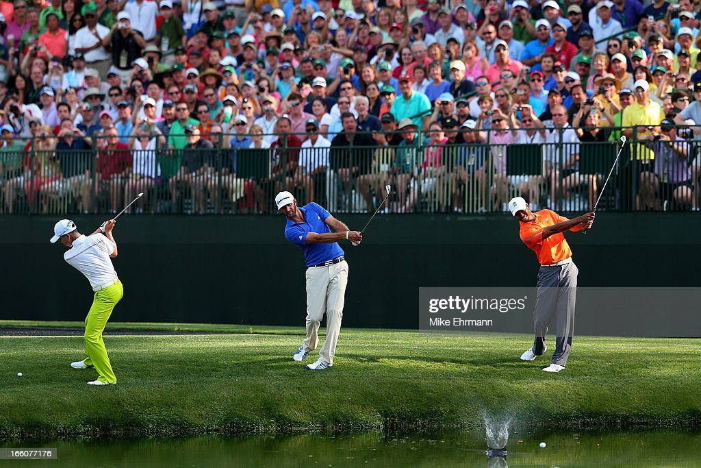 Tianlang Guan of China, <a gi-track='captionPersonalityLinkClicked' href=/galleries/search?phrase=Dustin+Johnson&family=editorial&specificpeople=3908453 ng-click='$event.stopPropagation()'>Dustin Johnson</a> of the United States and <a gi-track='captionPersonalityLinkClicked' href=/galleries/search?phrase=Tiger+Woods&family=editorial&specificpeople=157537 ng-click='$event.stopPropagation()'>Tiger Woods</a> of the United States all hit a shot at the same time on the 16th hole during a practice round prior to the start of the 2013 Masters Tournament at Augusta National Golf Club on April 8, 2013 in Augusta, Georgia.