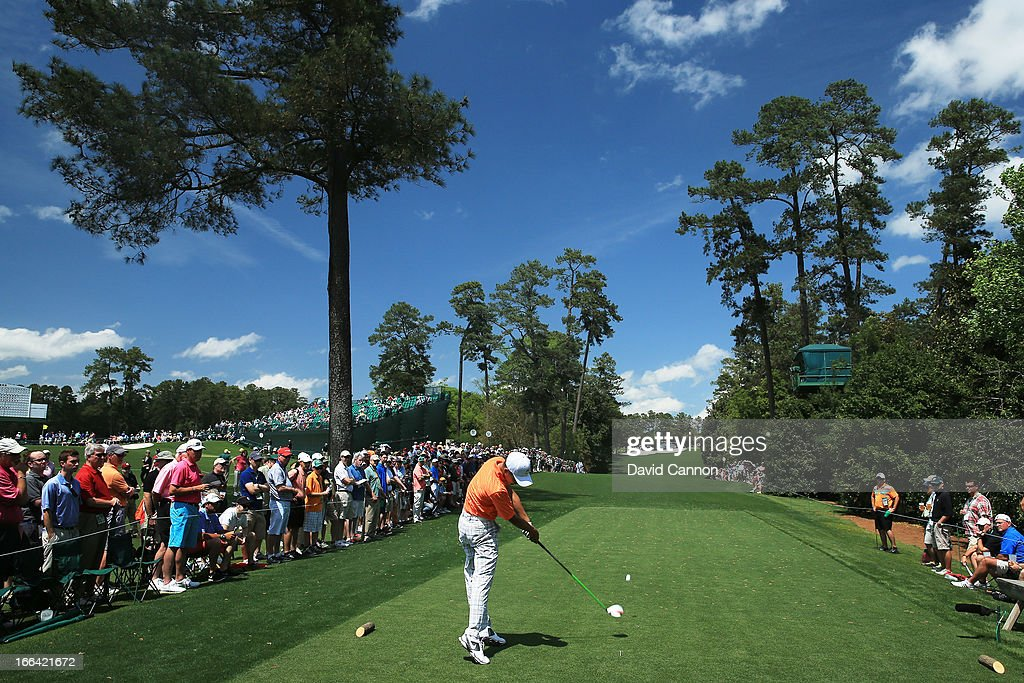 Tianlang Guan of China hits a tee shot on the 18th hole during the second round of the 2013 Masters Tournament at Augusta National Golf Club on April 12, 2013 in Augusta, Georgia.