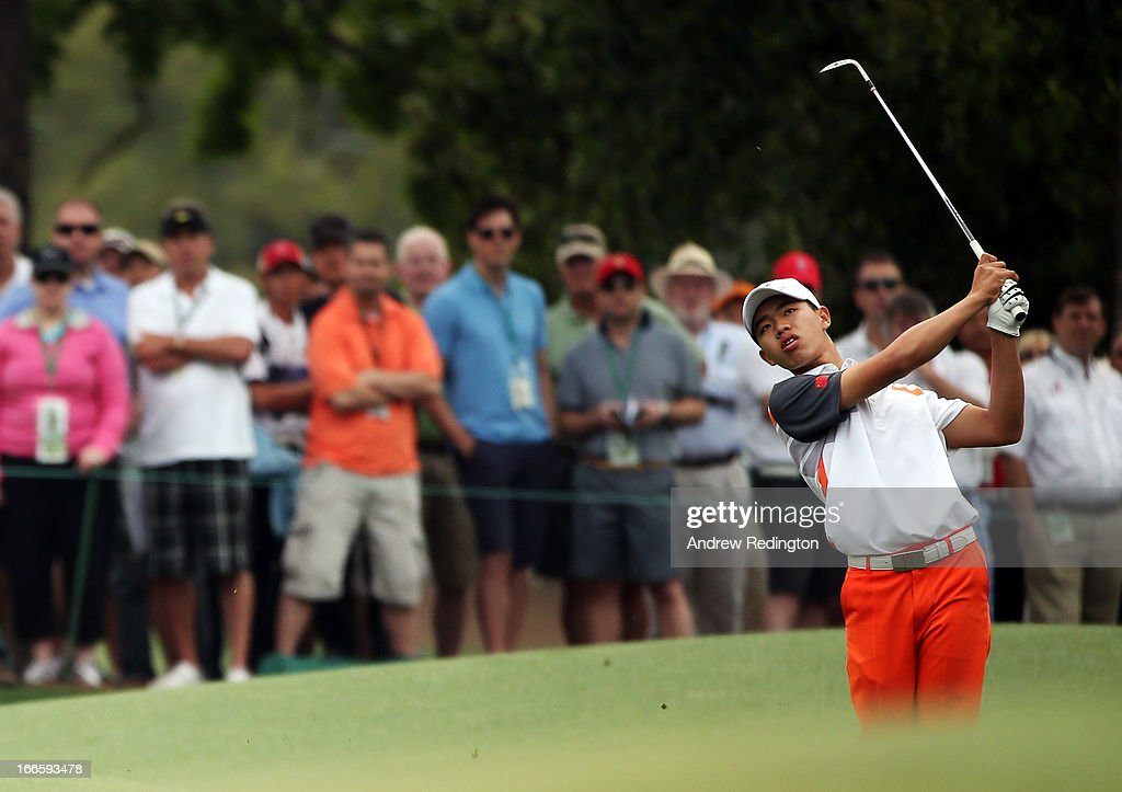 Tianlang Guan of China hits his third shot on the 8th hole during the final round of the 2013 Masters Tournament at Augusta National Golf Club on April 14, 2013 in Augusta, Georgia.