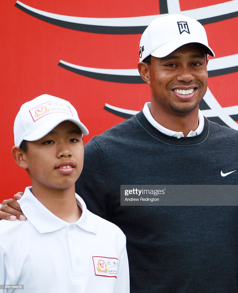 Tianlang Guan of China (L) with <a gi-track='captionPersonalityLinkClicked' href=/galleries/search?phrase=Tiger+Woods&family=editorial&specificpeople=157537 ng-click='$event.stopPropagation()'>Tiger Woods</a> of the USA pose before the pro-am prior to the start of the WGC-HSBC Champions at Sheshan International Golf Club on November 3, 2010 in Shanghai, China.