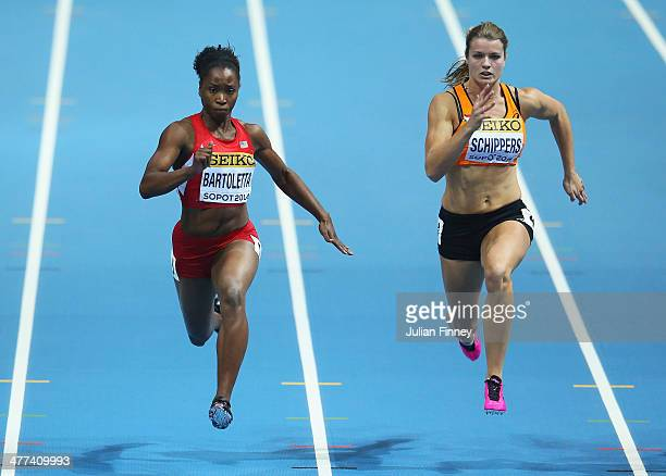 Tianna Bartoletta of the United States competes with Dafne Schippers of Netherlands in the Women's 60m Semi Finals during day three of the IAAF World...