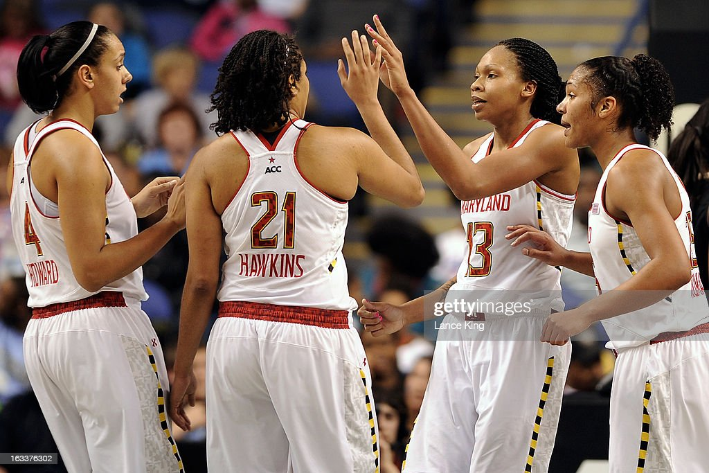 Tianna Hawkins #21 high-fives Alicia DeVaughn #13 of the Maryland Terrapins against the Wake Forest Demon Deacons during the quarterfinals of the 2013 Women's ACC Tournament at the Greensboro Coliseum on March 8, 2013 in Greensboro, North Carolina.