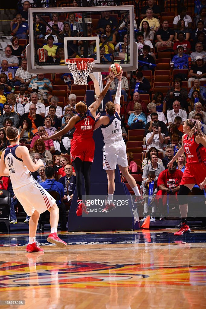 Tianna Hawkins #21 of the Washington Mystics blocks a shot against Kelsey Griffin #5 of the Connecticut Sun on August 15, 2014 at the Mohegan Sun Arena in Uncasville, Connecticut.
