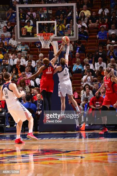 Tianna Hawkins of the Washington Mystics blocks a shot against Kelsey Griffin of the Connecticut Sun on August 15 2014 at the Mohegan Sun Arena in...