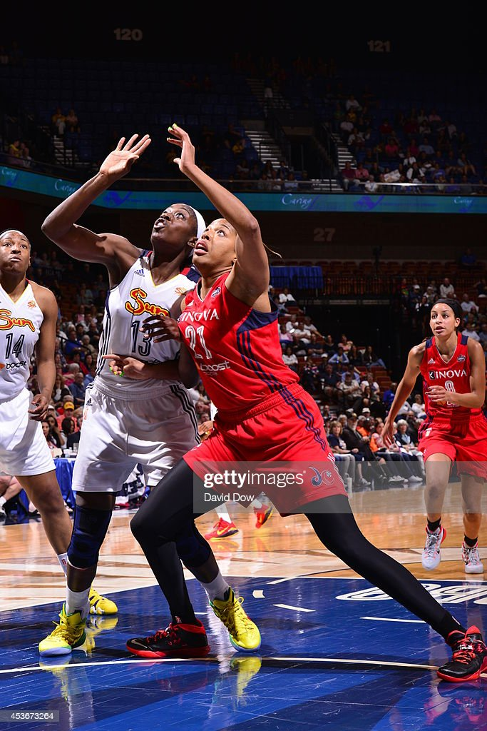 Tianna Hawkins of the Washington Mystics boxes out against Chiney Ogwumike of the Connecticut Sun on August 15 2014 at the Mohegan Sun Arena in...