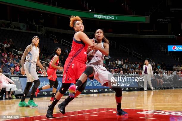 Tianna Hawkins of the Washington Mystics boxes out against Rebekkah Brunson of the Minnesota Lynx on June 9 2017 at Verizon Center in Washington DC...