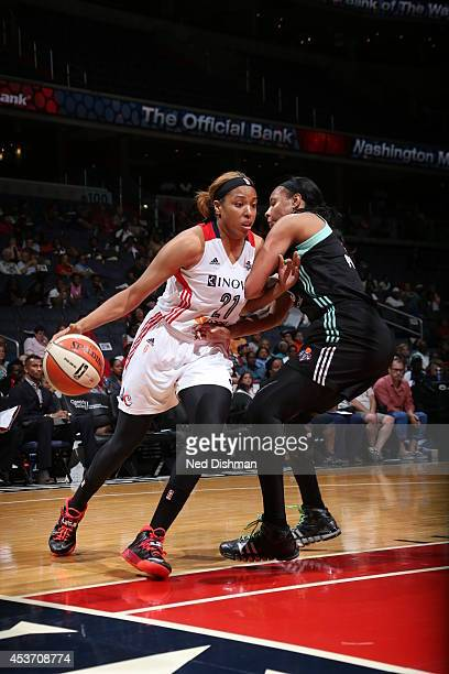 Tianna Hawkins of the Washington Mystics drives against Plenette Pierson of the New York Liberty at the Verizon Center on August 16 2014 in...